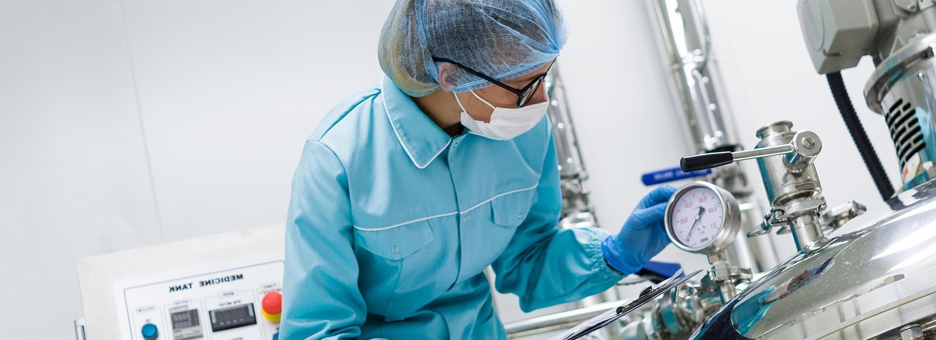 Women in mask working in laboratory