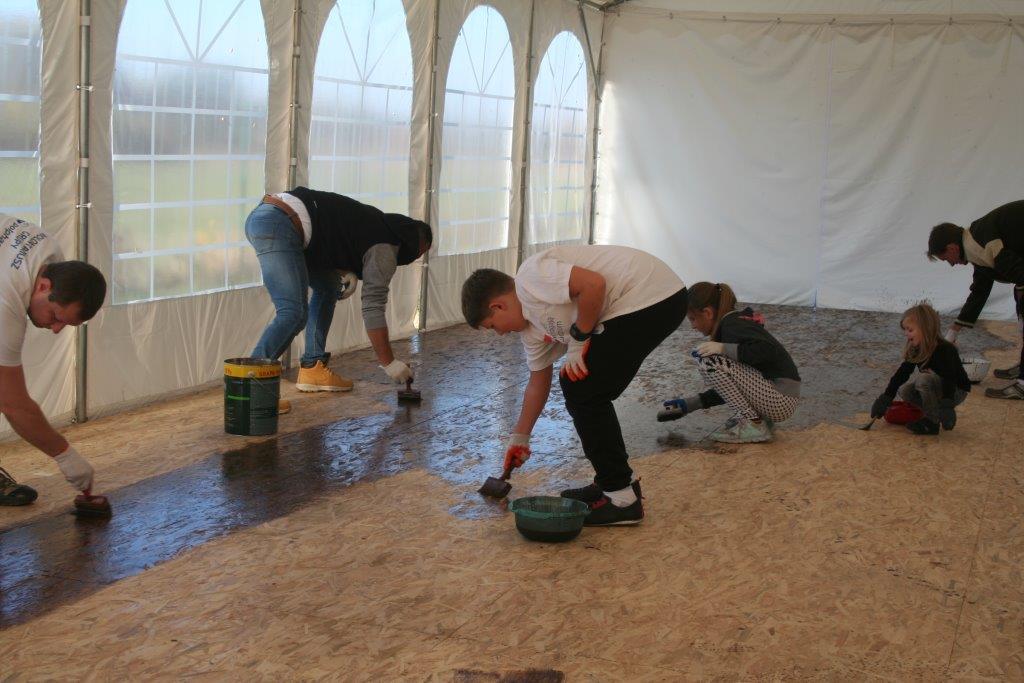 Volunteers renovate the floor